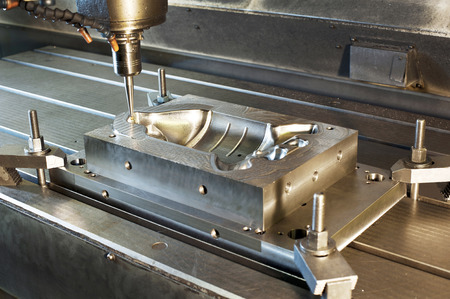 mounting holes: Industrial metal mold blank milling. Metalworking and mechanical engineering. CNC technology.