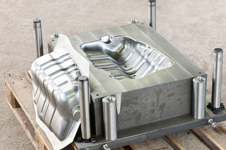 Industrial metal matrix mold make with iron dieblank of muffler. Lathe milling and drilling industry. Mechanical engineering and metalworking. CNC technology.