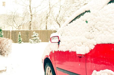 snow capped: Red car and mirror snow capped. Winter-time outside. Outdoors. Stock Photo
