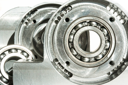 chrome base: Mounted roller bearing unit die. CNC technology. Milling lathe and drilling industry. Metalworking. Mechanical engineering. Indoors closeup.