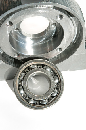chrome base: Mounted roller bearing unit die. Milling lathe and drilling industry. Metalworking, mechanical engineering and CNC technology. Indoors closeup.