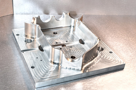 mounting holes: Industrial metal mold blank. Metalworking. CNC milling technology. Mechanical engineering