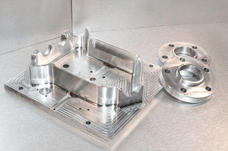 Metal moldblank and steel flanges. Milling and drilling industry. CNC technology. Mechanical engineering