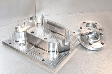 cnc: Metal moldblank and steel flanges. Milling and drilling industry. CNC technology. Mechanical engineering