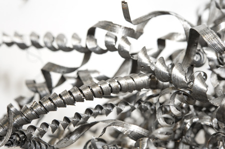 Closeup twisted spiral steel shavings. Drilling, lathe and milling industry. Metal engineering technology.