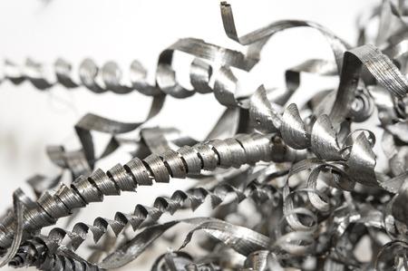 metales: Virutas espirales retorcidas Primer acero. Perforaci�n, torno y moliner�a. Tecnolog�a de la ingenier�a metal. Foto de archivo