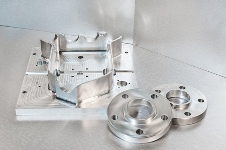 mounting holes: Semi-finished steel blank and flanges. Mechanical engineering. Milling and lathe industry. CNC technology. Stock Photo