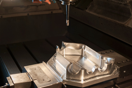 mounting holes: Industrial steel mold blank milling. Metalworking and mechanical engineering. CNC technology. Stock Photo