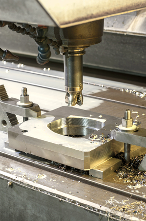 mounting holes: Square industrial metal moldblank milling. Metalworking, mechanical engineering, lathe, milling and drilling technology. Indoors vertical image. Stock Photo