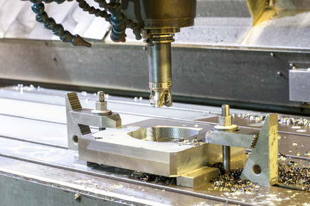 mounting holes: Square industrial metal moldblank milling. Metalworking, mechanical engineering, lathe, milling and drilling technology. Indoors horizontal image.