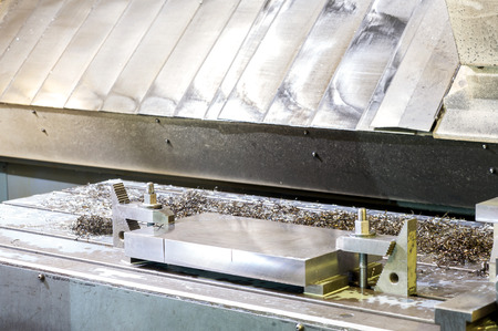 punch press: New industrial metal moldblank preparation for milling process . Metalworking, mechanical engineering, lathe, milling and drilling technology. Indoors horizontal image. Stock Photo