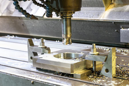 Square industrial metal mold/blank milling. Metalworking, mechanical engineering, lathe, milling and drilling technology. Indoors horizontal image.