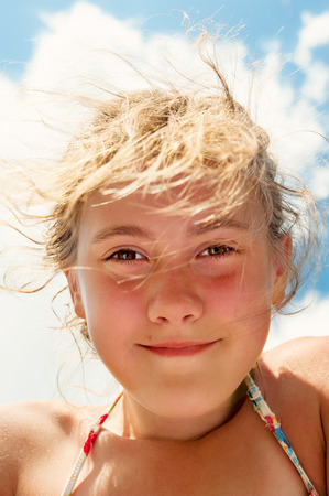 beautiful eye: Low angle view of beautiful  smiling playful girl closeup portrait. Vibrant summertime vertical image.