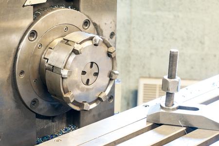 Horizontal side mill machine. Metalworking, mechanical engineering, lathe and milling technology. Indoors horizontal image. Stock Photo