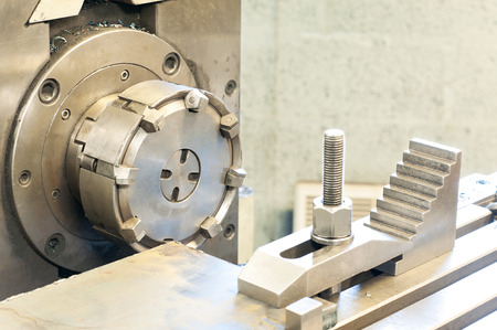 End milling with horizontal side mill machine. Metalworking, mechanical engineering, lathe and milling technology. Indoors horizontal image. Stock Photo