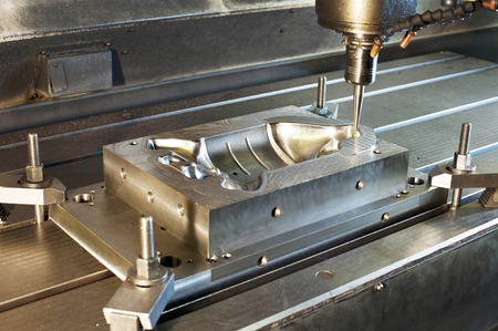 Industrial metal mold blank milling. Metalworking and mechanical engineering. CNC technology. Milling, lathe and drilling industry.