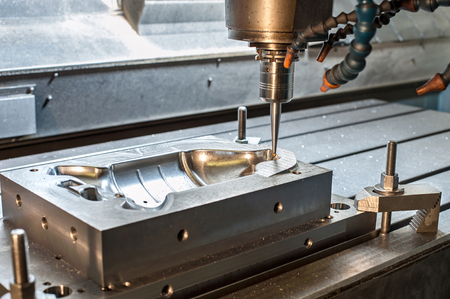 mounting holes: Industrial metal moldblank milling. Metalworking. Lathe, milling and drilling industry. CNC technology. Stock Photo