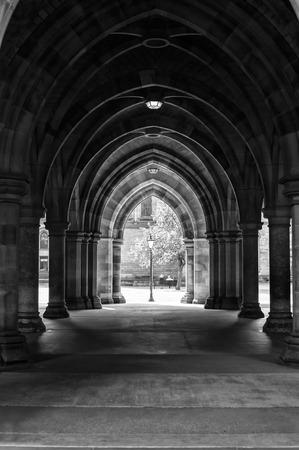 arcades: Arcades of old Glasgow University corridor cloisters. UK, Scotland. Black and white image. Stock Photo