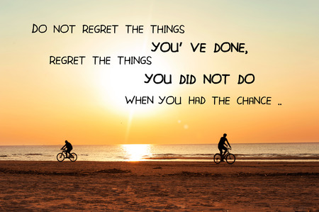 Dont regret the things youve done, regret the things you didnt do when you had the chance. Inspirational motivation quote on sunset background. Vibrant multicolored outdoors horizontal image. Copy space.