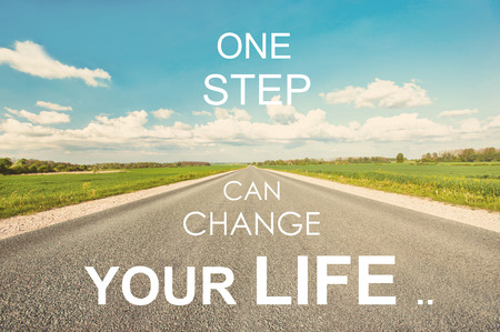 life change: One step can change your life. Motivational inspiration quote with road on blue cloudy sky background. Vibrant colored outdoors  horizontal image with filter