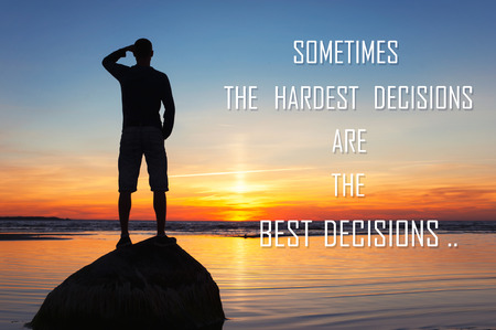 Sometimes the hardest decisions are the best decisions. Inspirational motivating quote with man silhouette on sunset background. Multicolored outdoors horizontal image. Copy space.