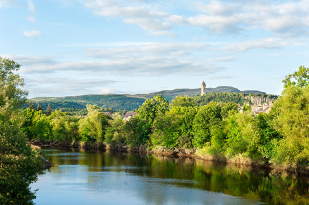 craig: The spectacular view of scottish nature with National Wallace Monument tower standing on the summit of Abbey Craig on background Hilltop near Stirling in Scotland. Colored horizontal outdoors image.