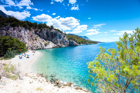 Stunning view of landscape with beautiful Adriatic Sea and quiet majestic bay with beach in Dalmatia, Croatia, Europe. Summertime multicolored vibrant outdoors horizontal image with blue sky background.