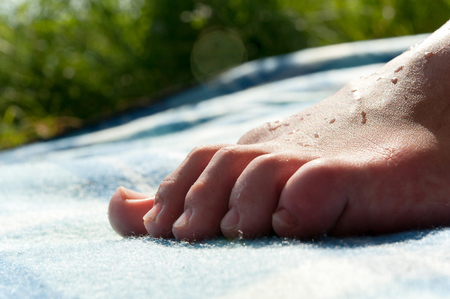Closeup image of child foot. skin and nails health. Horizontal outdoor image.