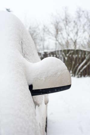 Car mirror snow capped. Outside vertical winter time image Archivio Fotografico