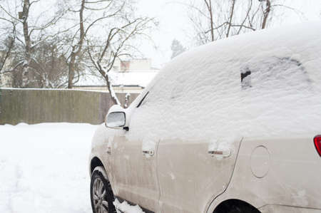 White dirty car snow capped. Outside horizontal winter time image Archivio Fotografico