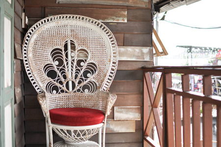 Old white arm chair with red seet photo