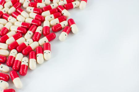 capsules: red capsules on white