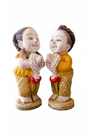Two Thai dolls (a boy and a girl) made from ceramic in the act of Thai greeting