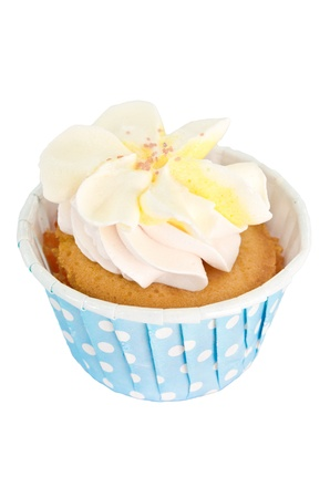 A cupcake with cream and some sugar in a blue paper cup Stock Photo