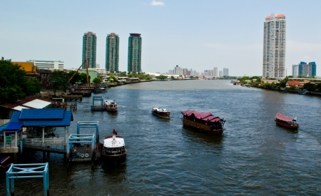 Chaopraya river and its riverside near Taksin Bridge, Bangkok Thailand Stock Photo
