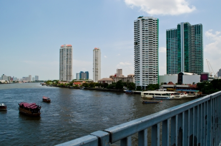 Chaopraya river with some ships and skyscrapers