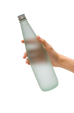 A hand holding a bottle of mineral water Stock Photo