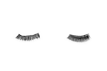 two artificial eyelashes on the white background