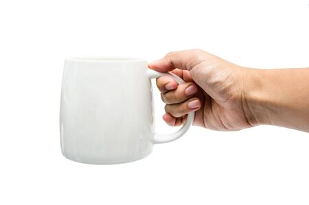 a hand holding a white cup Stock Photo