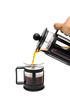 french ethnicity: a hand pouring coffee from a french-press coffee maker