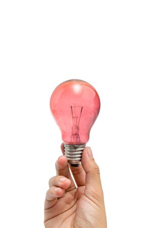a hand holding a red lightbulb Stock Photo