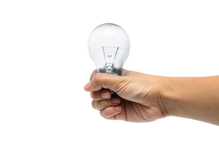 a hand holding a colorless lightbulb Stock Photo
