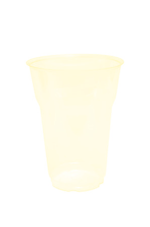 an empty yellow transparent disposible glass
