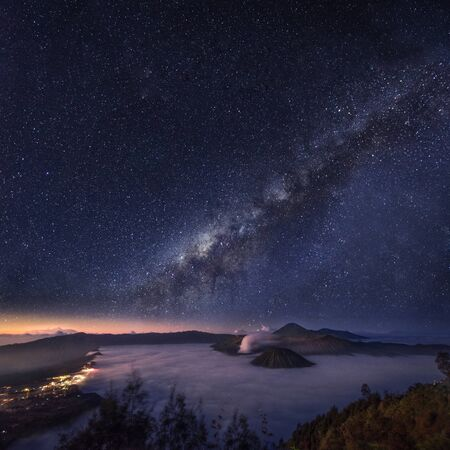 Mt. Bromo with the mist under the milky way at sunrise