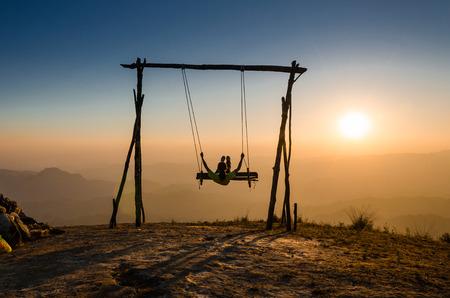 a girl swinging under the sunlight