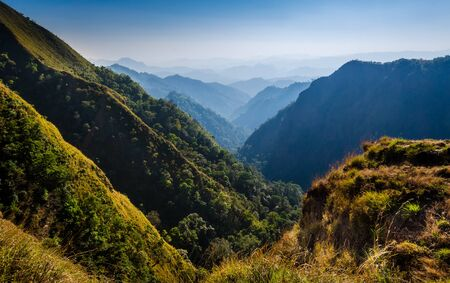 yellow, green and blue mountains in a sunny day Stock Photo