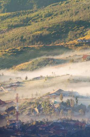 rural town under fog in Indonesia