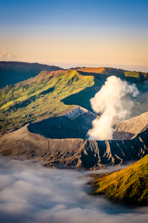 Zoom image of mount bromo with fog and sunlight in Indonesia