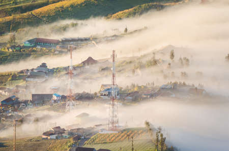 rural town under fog in Indonesia