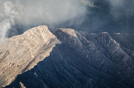 Zoom image of mount bromo with smoke in Indonesia